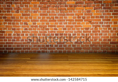 Empty room with brickwall and parquet floor - stock photo