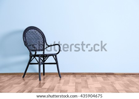 Empty room with  chair  on blue wall background - stock photo