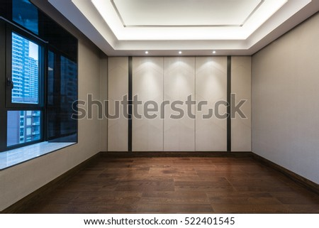 Empty room with dark brown parquet flooring and wall paper decoration