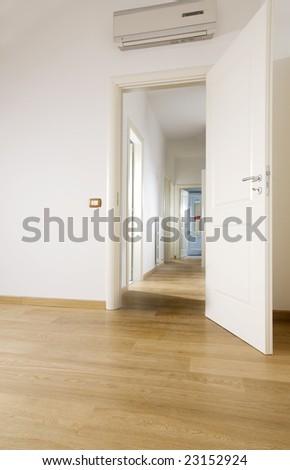 empty room with hardwood floor - stock photo