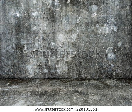 empty room with old mottled concrete wall and floor for background texture - stock photo