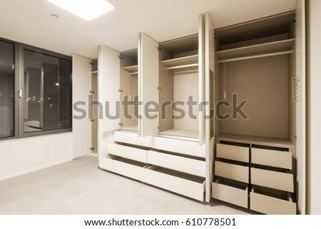 empty room with opened white wood floor lighting