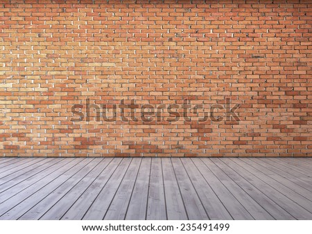 empty room with red brick wall and wooden floor  - stock photo