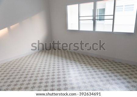 empty room with sliding window and beige tile floor