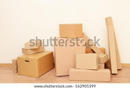 Empty room with stack of cartons: moving house concept  - stock photo