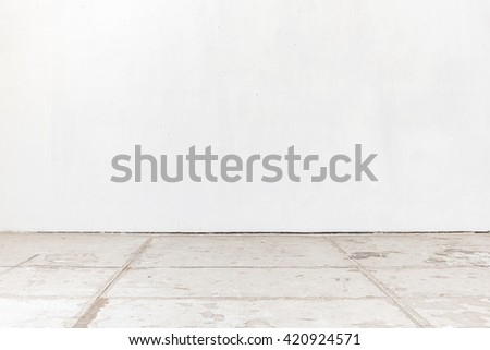 empty room with white wall and concrete floor for interior design - stock photo