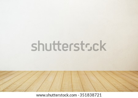 empty room with white wall and wooden floor - stock photo