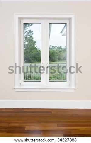 empty room with wood floors and view windows