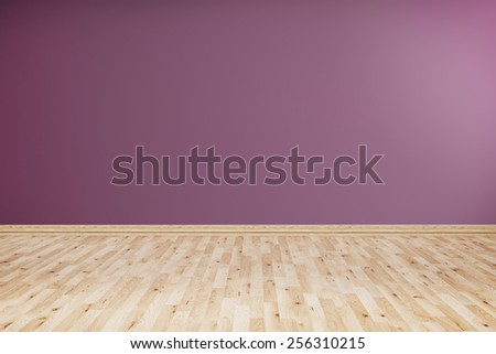 Empty room with wooden floor and violet wall. - stock photo