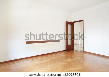 Empty room with wooden floor in normal apartment - stock photo