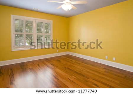 empty room with yellow walls and view windows - stock photo