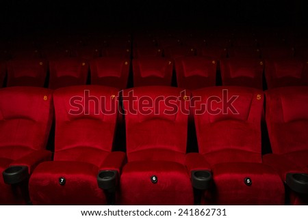 Empty rows of red theater or movie seats - stock photo