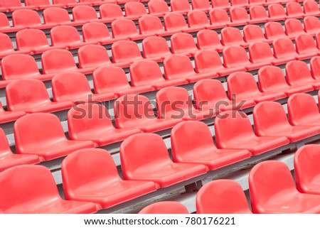 Empty rows with red  seats on a stadium