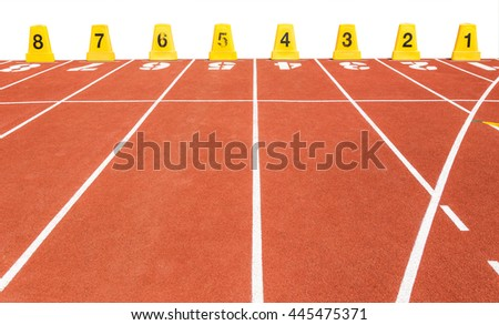 empty running track with lane numbers in the stadium on white background - stock photo
