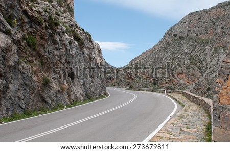 Empty rural road through the  beautiful  gorge of Kourtaliotikos in Crete Island in Greece.
