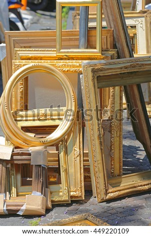 Empty Rustic Gold Picture Frames at Flea Market - stock photo