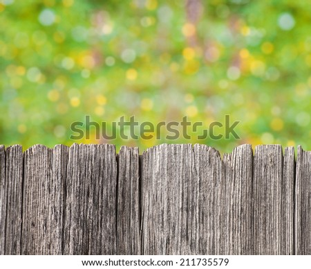 Empty rustic wooden board with abstract summer background - stock photo