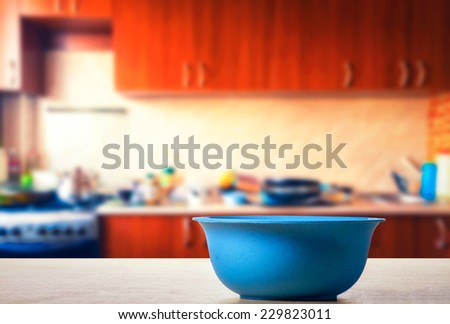 Empty salad bowl on the table - stock photo