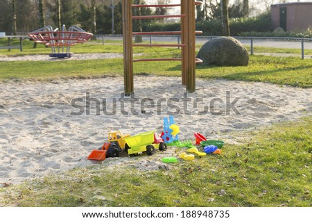 empty sandpit with colorful toys  - stock photo