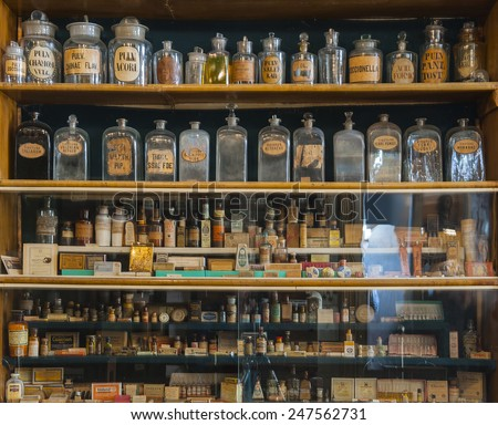 Empty scent bottles in old pharmacy - stock photo
