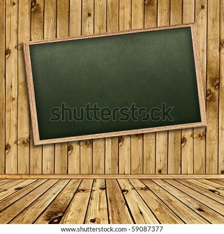 Empty school blackboard at wall in wooden interior - stock photo