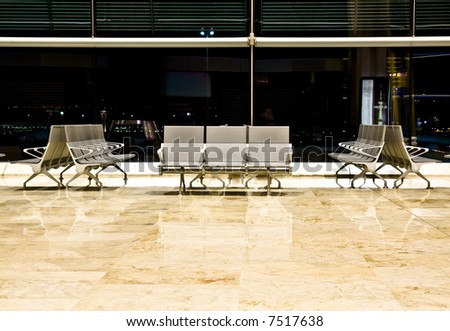 Empty seating at the airport departure area - stock photo