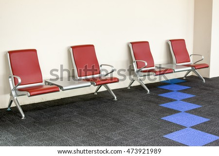 empty seats at a business building against a wooden wall (gorgeous interior setting). Airport Seating
