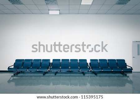 empty seats at a business building with white wall,  in blue tune - stock photo