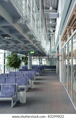 Empty seats at an airport waiting lounge - stock photo