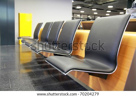 Empty seats at the airport in waiting area - stock photo