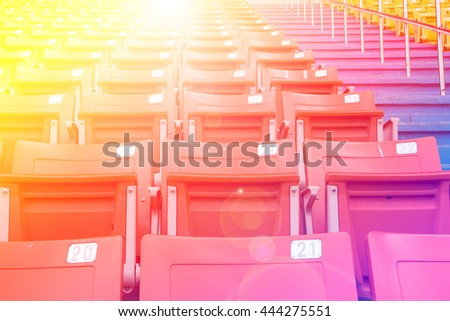 Empty seats at the stadium with color filters - stock photo
