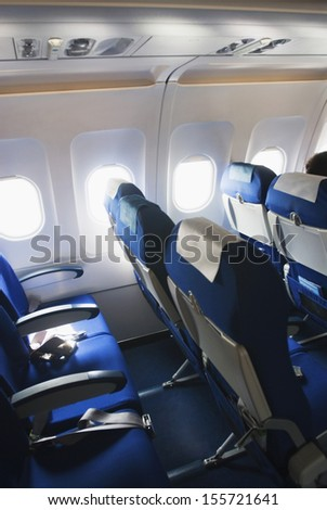 Empty seats in an airplane