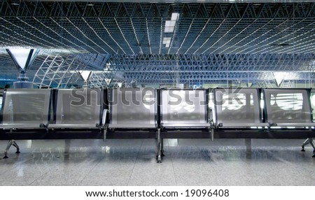 Empty seats in an airport waiting room or lounge - stock photo