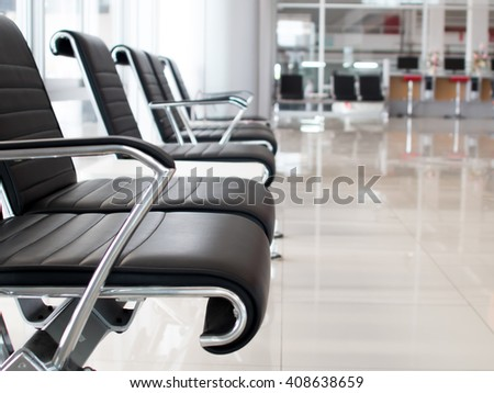 Empty seats in modern building with light from windows