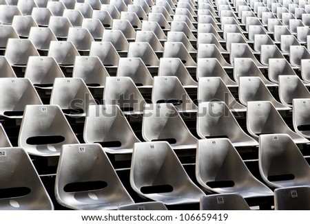 Empty seats in outdoor concert hall - stock photo