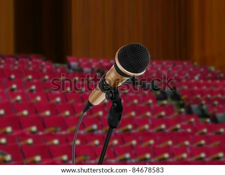 empty seminar hall and microphone - stock photo