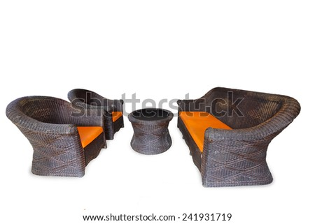 Empty Set of armchair chairs modern design made from skill handwoven rattan natural brown color. With orange cushions pillow for sit  isolated on white background. This has clipping path. - stock photo