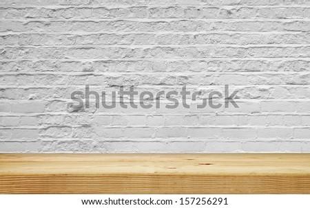 empty shelf on white brick wall - stock photo