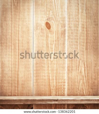 Empty shelf on wooden wall. Wooden texture. - stock photo