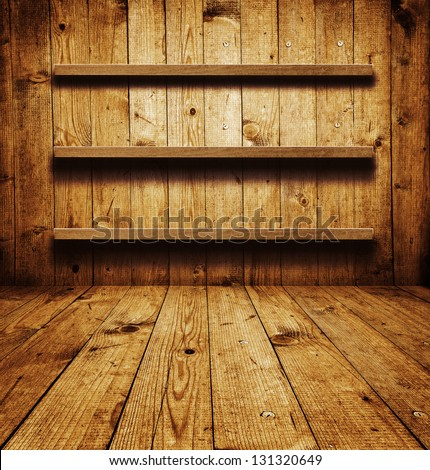 Empty shelf. Vintage wooden bookshelf over a grungy background - stock photo