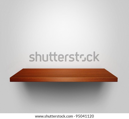 Empty shelf with copy space hanging at the wall - stock photo