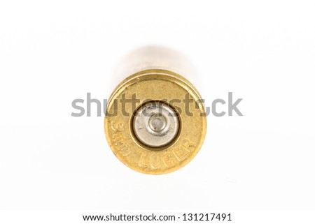 Empty shell casing against gradient, isolated on white - stock photo