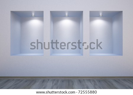 Empty shelves in a wall-honored spotlights