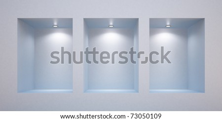 Empty shelves in a wall-honored spotlights - stock photo