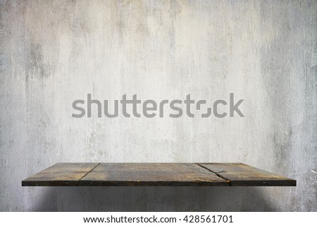 empty shelves on concrete wall