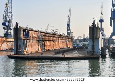 empty Shipyard floating dry dock in the Rotterdam sea port - stock photo