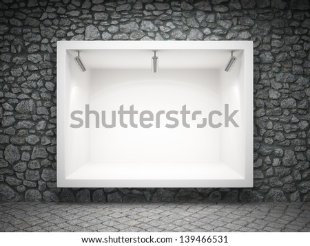 Empty shop window in the ancient stone wall - stock photo