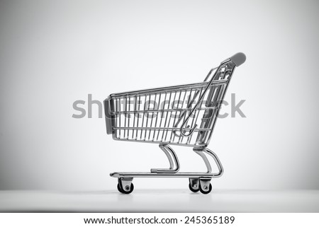 Empty shopping cart, isolated on light background.