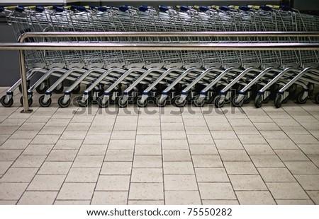 Empty shopping trolleys in a market - stock photo