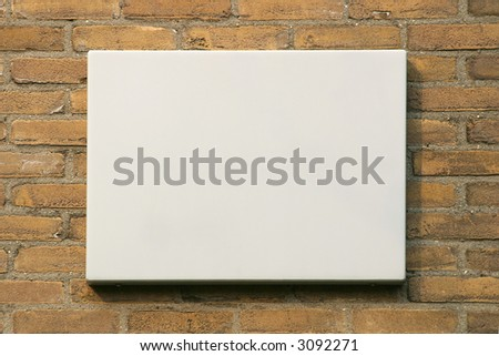 Empty sign against brick wall. Add your own text. - stock photo